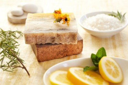 Spa still life of organic soap, salt scrub, rosemary, lemon