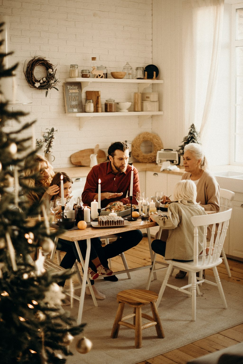 family-sitting-near-dining-table-and-eating-food-3171157