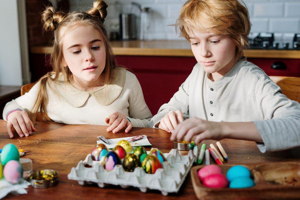 children-decorating-easter-eggs-3972145
