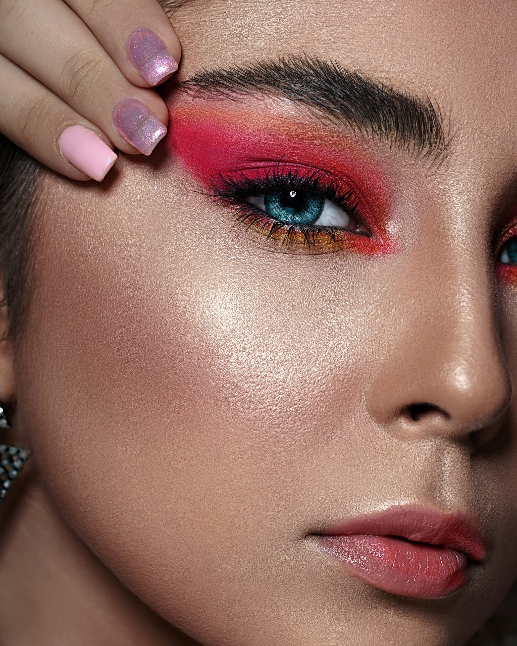 close-up-photo-of-woman-with-pink-eyeshadow-3912572