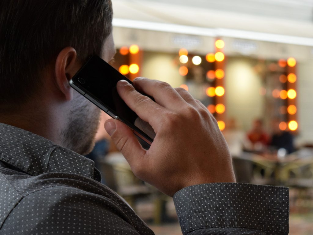 person-using-phone-selective-focus-photography-163135