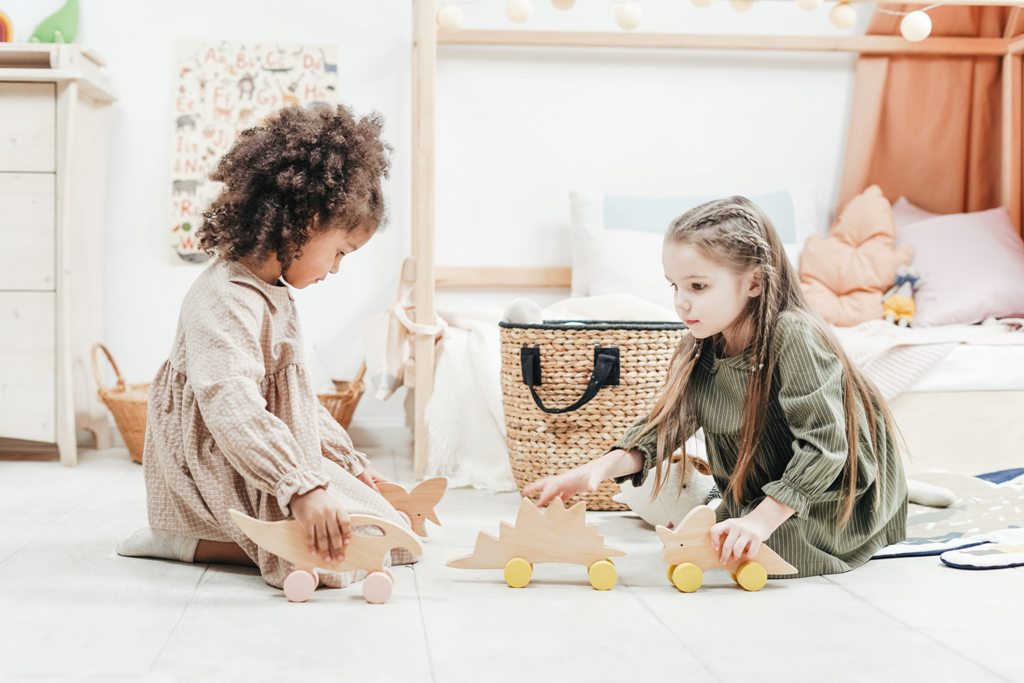 photo-of-girls-playing-with-wooden-toys-3662822