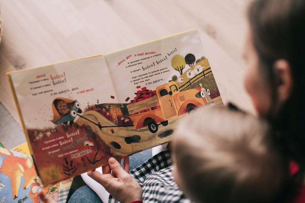 woman-reading-book-to-toddler-1741231